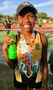 Qitarh smiling after winning athletic race win