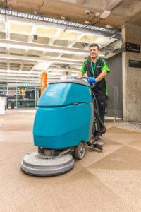 Man with Floor scrubber in Arts Precinct low shot