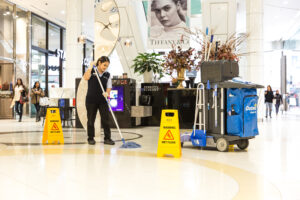 Woman Mopping at Queens Plaza near Tiffanys