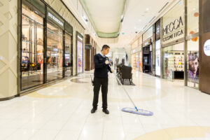 Man Mopping at Queens Plaza Mall from distance