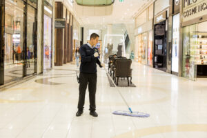 Man Mopping at Queens Plaza Mall
