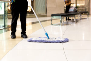 Dry mopping in Queens Plaza