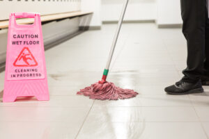 Mopping in bathroom pink wet sign