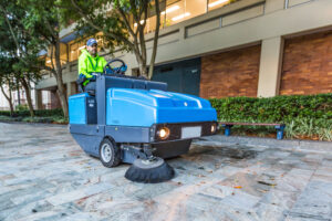 Street sweeper on pavement