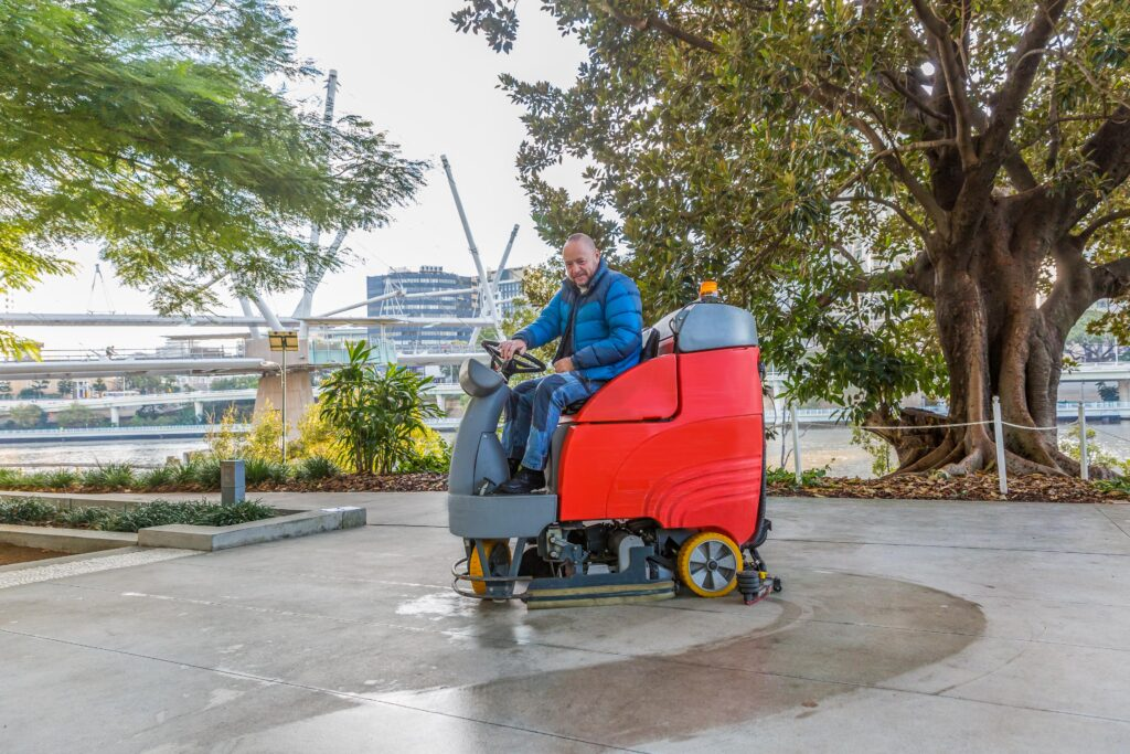 Arts Precinct Smiling Scrubbing machine operator