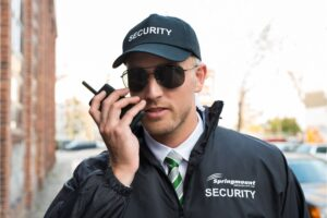 Springmount Security Guard jacket, cap and with walkie talkie