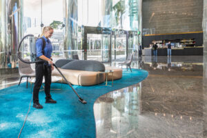 Female Vacuuming conference centre reception