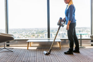 Vacuuming commercial office building carpet