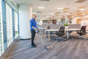 Female Vacuuming office building