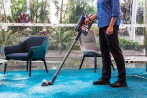 Female Vacuuming reception waiting area
