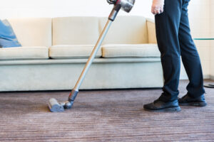 Vacuuming reception carpet