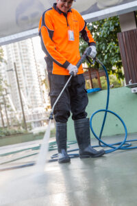 Close up Male pressure cleaning in Arts Precinct