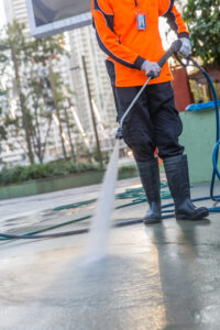 Hoses and Arts Precinct pressure cleaning machine operator