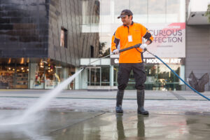 Afternoon Arts Precinct pressure cleaning machine and operator
