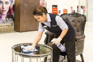 Close up Female Springmount Team member cleaning table at Queens Plaza
