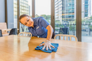 Female Springmount Team member cleaning table