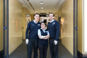 Smiling team of 3 from Queens Plaza